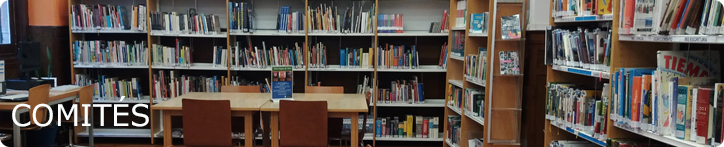 Banner de la sección comités, se ve una sala de biblioteca llena de estanterías y libros y alguna silla